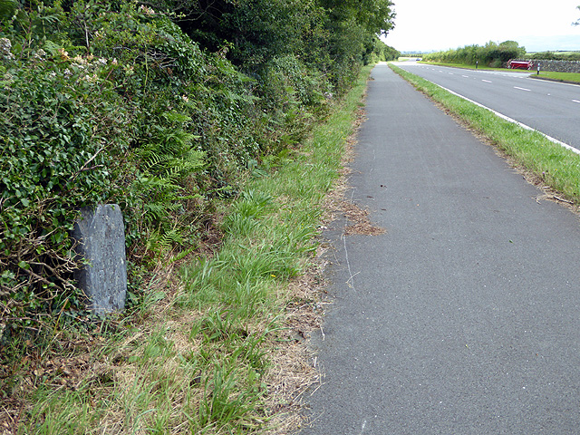Milestone beside the A497 road