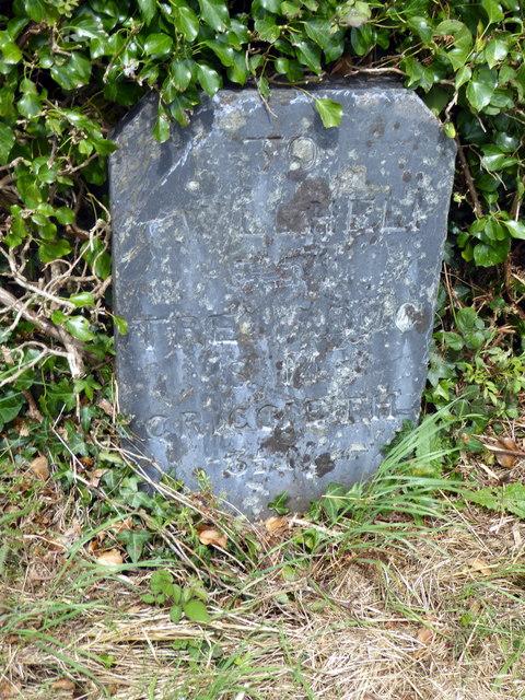 Detail view of a milestone beside the A497 road near Afon Wen Farm
