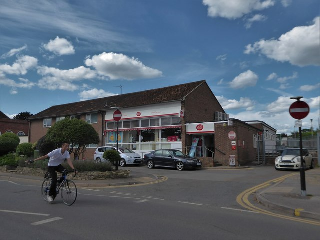 Cyclist passing the post office