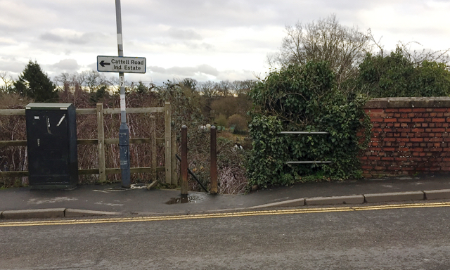 Street furniture and sign by Cape Road, Warwick