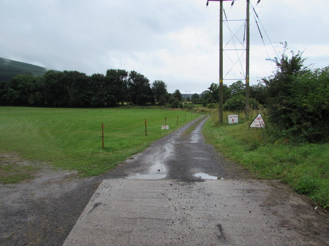 Side road past a car boot sale field near Govilon