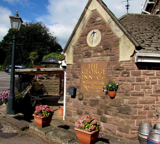 Old sundial on a corner of the George Inn, Aylburton