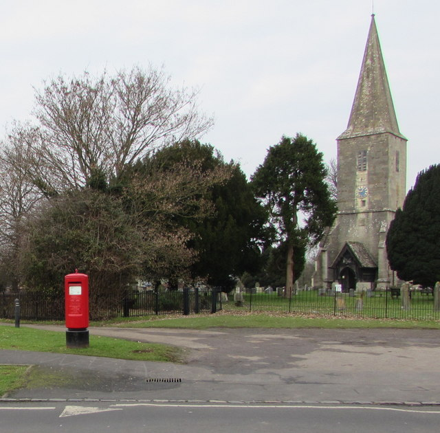 Queen Elizabeth II pillarbox and a church tower with spire, Quedgeley