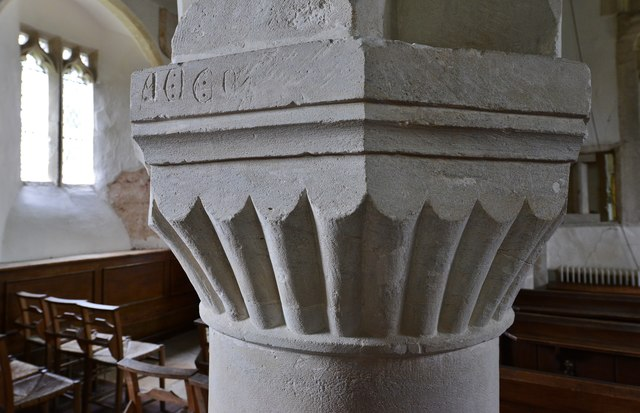Little Barrington, St. Peter's Church: Norman scalloped capital with inscription  in the nave