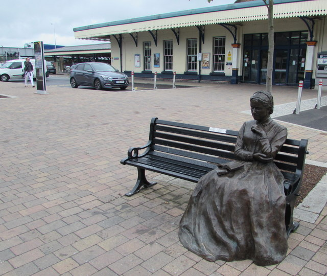 Seated statue on a bench outside Eastleigh railway station