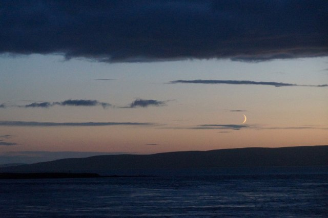 Crescent moon beyond Thieves Holm, Wide Firth
