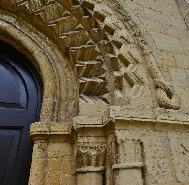 Bishops Cleeve, St. Michael and All Angels Church: Norman west doorway capitals and serpent eating itself