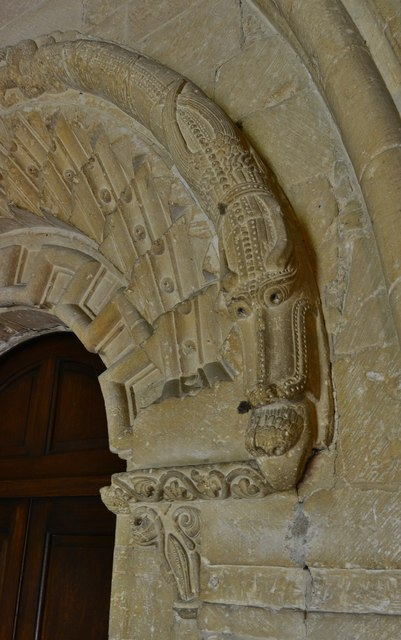 Bishops Cleeve, St. Michael and All Angels Church: Monster consuming another creature on the south doorway
