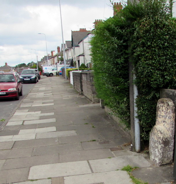 Pavement and old milestone on the east side of Newport Road, Rumney, Cardiff