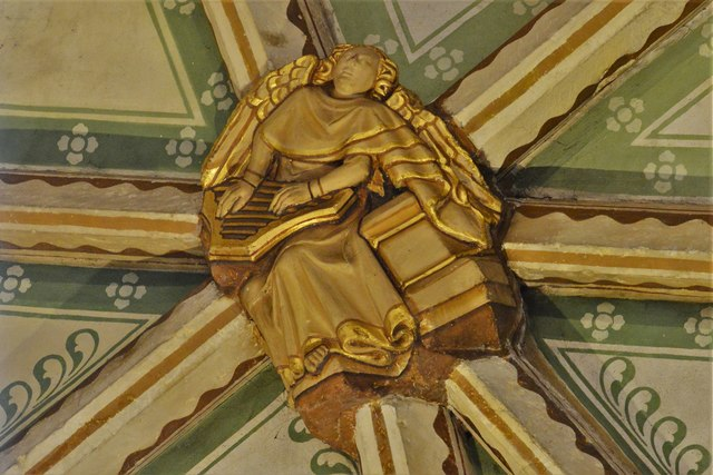 Tewkesbury Abbey, nave lierne vault boss: Angel musician playing the psaltery