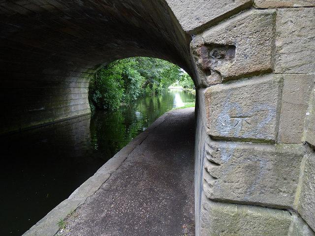 Benchmark on canal bridge, Leeds and Bradford Road