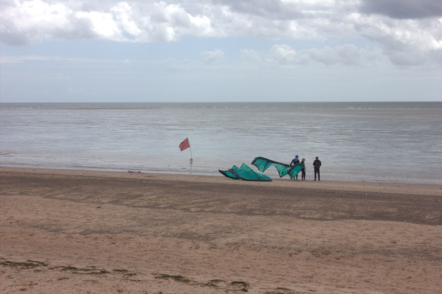 Exmouth beach, paragliders