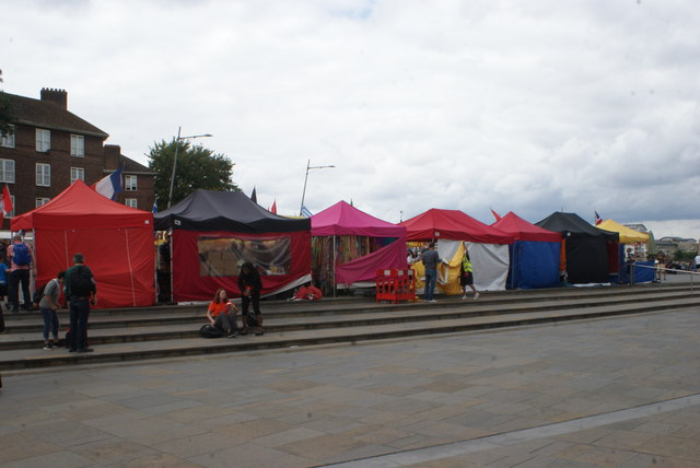 View of colourful market stalls in front of the Cutty Sark