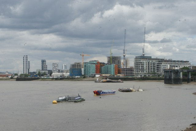 View of several new blocks of flats under construction on the Greenwich riverside from the Thames Path