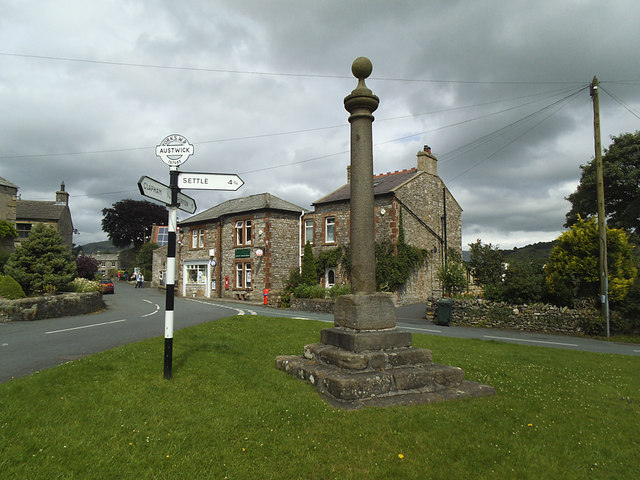 Austwick market cross and signpost