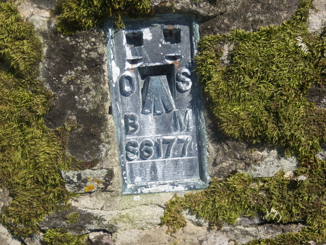 Details on the flush bracket of the stone built trig point on Ailsa Craig