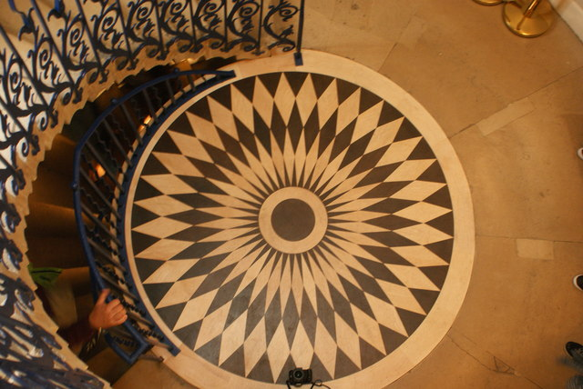 View of a circular floor pattern at the bottom of the Tulip Staircase #3