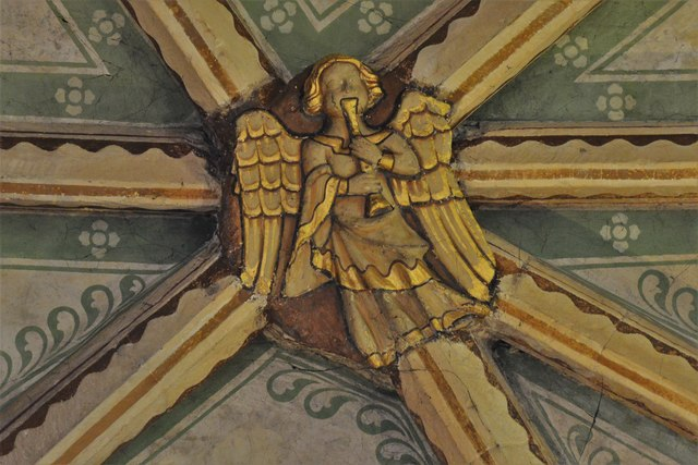 Tewkesbury Abbey, nave lierne vault boss: Angel playing the shawm