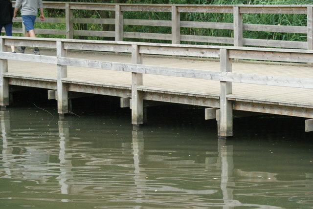 View of the wooden walkway reflected in Connaught Water