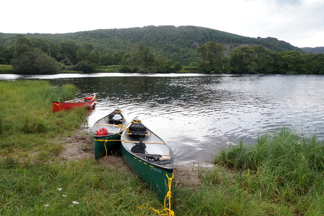 Canoes drawn up beside the River Beauly at Aigas