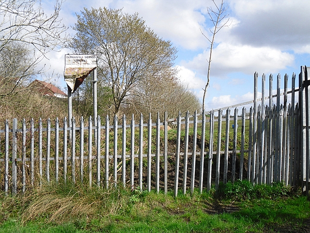 Fence and old sign at former landfill site