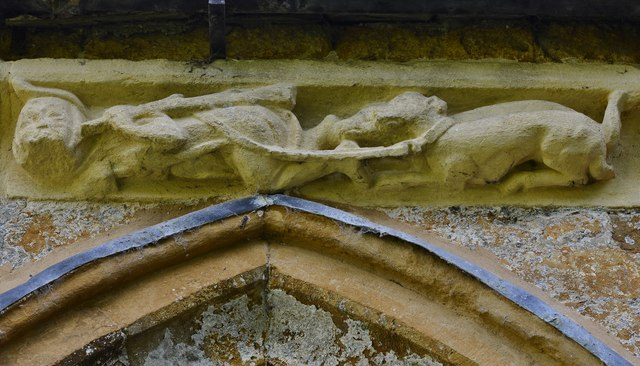 Hanwell, St. Peter's Church: North frieze, ca. 1340: Cudgel wielding hunter and dog
