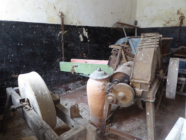 Calke Abbey - roomful of abandoned agricultural machinery