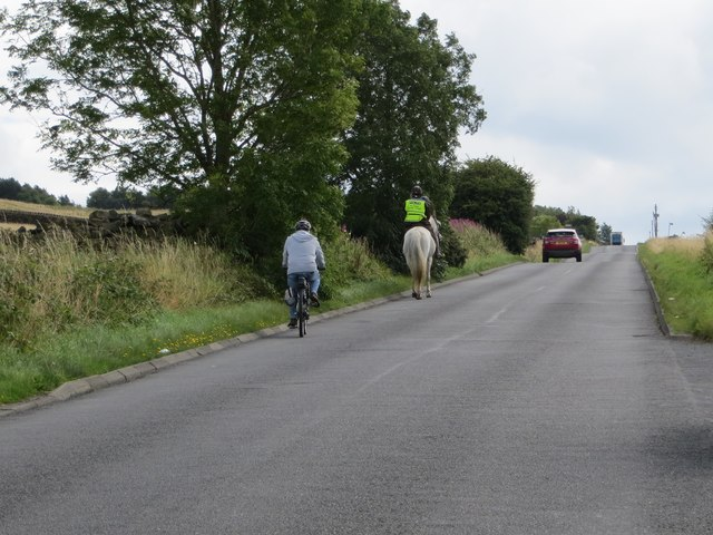 Three modes of transport (Bike, Horse and Automobile) ascending Yorkgate near Otley