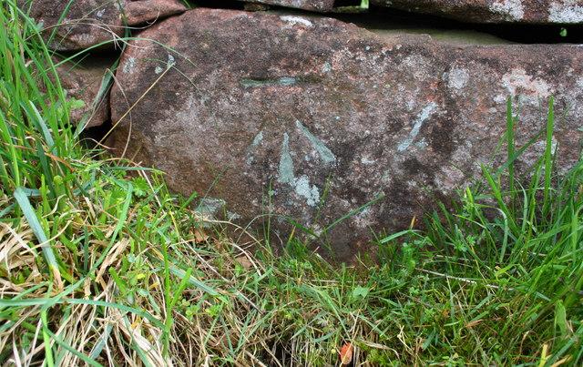 Benchmark on boulder at base of Salkeld Road wall