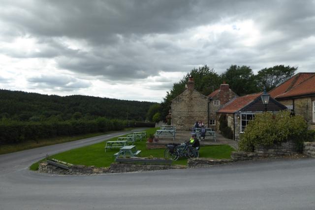 Stone Trough Inn under a darkening sky