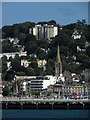SX9163 : Torquay: harbourside buildings and church spire by Derek Harper