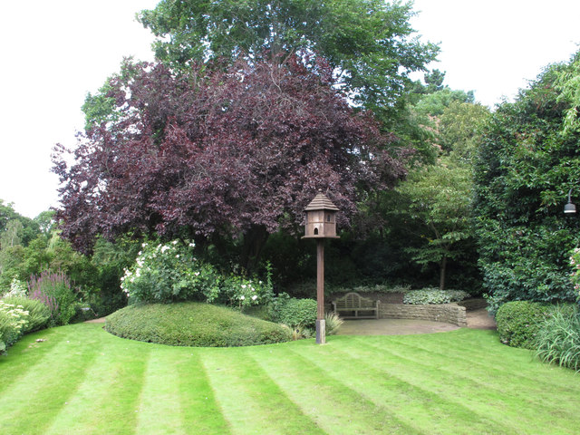 The Holme, wooden dove house on pole in lawn