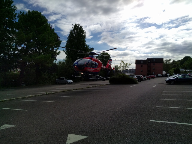 Air ambulance lifting off from the car park