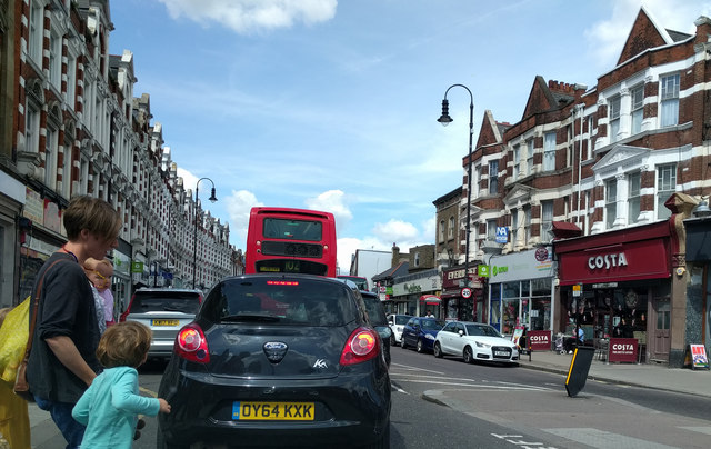 Shops, traffic and pedestrians in Muswell Hill