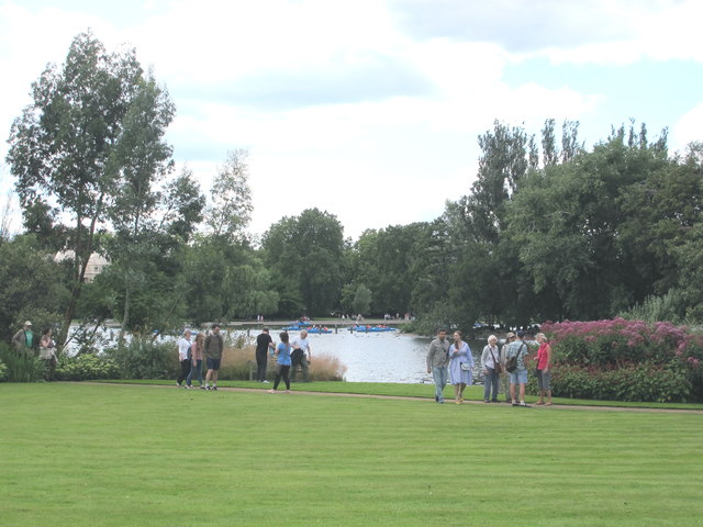 The Holme, visitors on lawn by boating lake