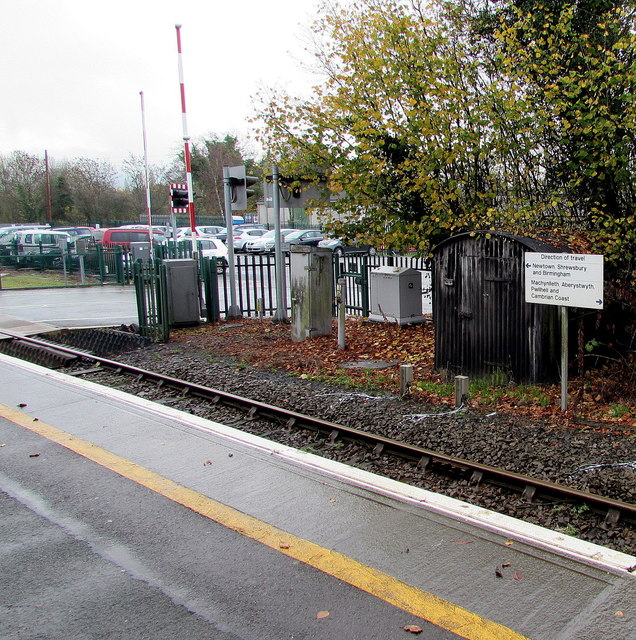 Direction of travel sign opposite Caersws railway station