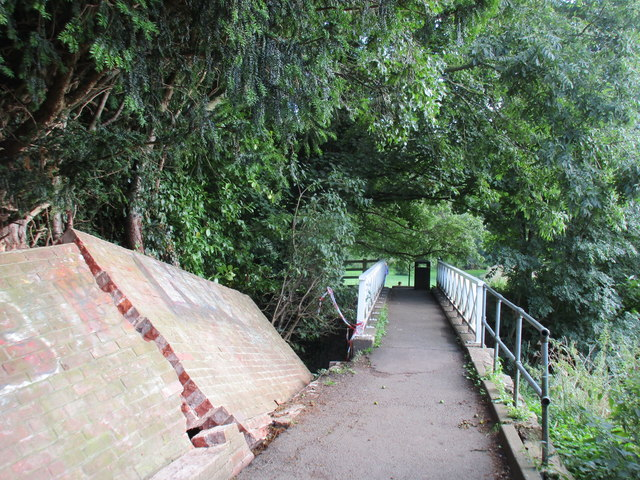 Footbridge and collapsed wall