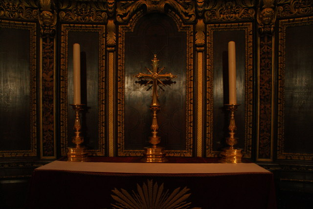 View of a cross and two candles at the rear of the altar in St. Paul's Cathedral