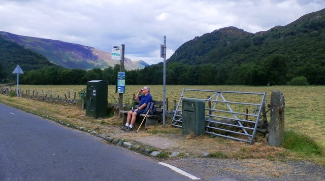 Rural Bus Stop with Weary Legs