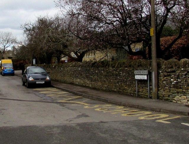 Zigzag yellow markings on School Road, Minchinhampton
