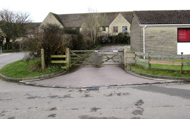 Wooden gate at the entrance to Minchinhampton Community Library car park