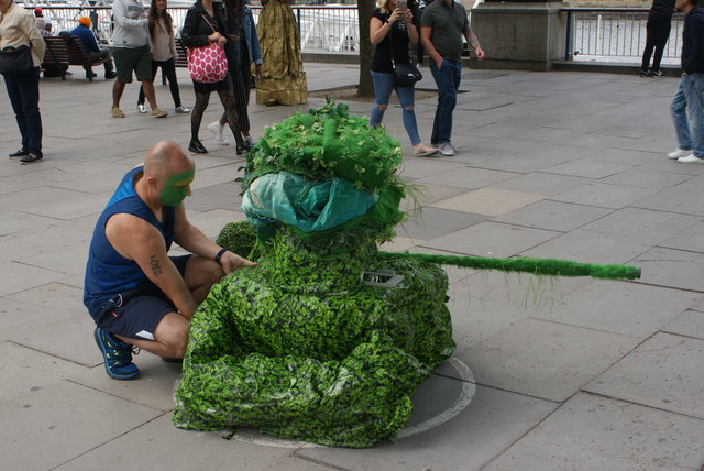 View of a green tank street entertainer on the South Bank