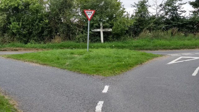 Road junction with  grass triangle