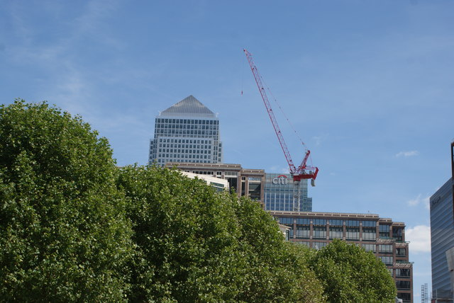 View of One Canada Square peeping above the trees from Canary Riverside