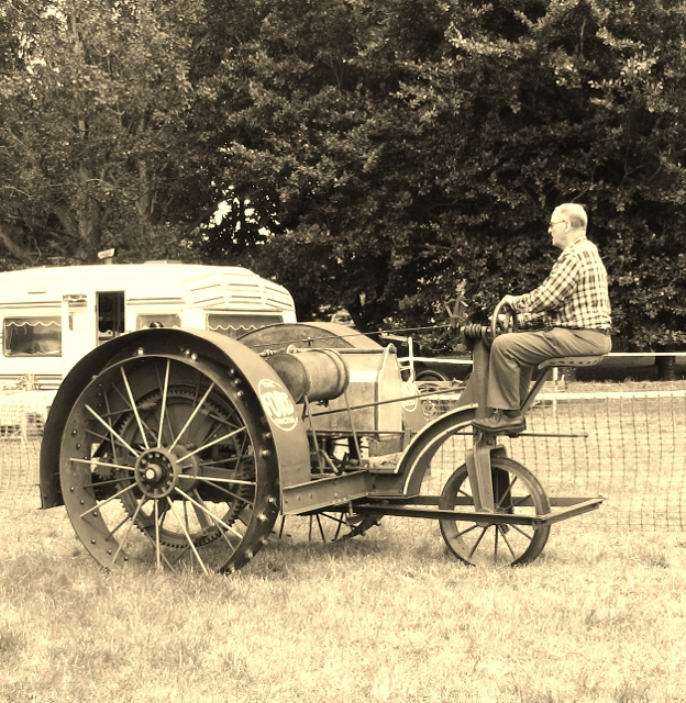 Gentleman driving The Ford Tractor