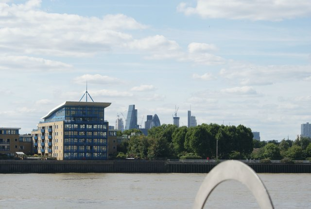 View of the Cheese Grater, Tower 42 and Gherkin from the Thames Path