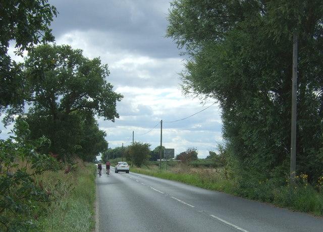 Cyclists on Twenty Pence Road (B1049)