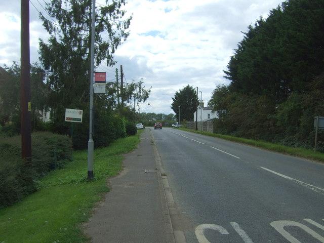Bus stop on Twenty Pence Road (B1049)