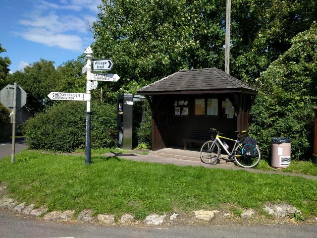 Bus shelter, phone box, rubbish bin and signpost at Edington