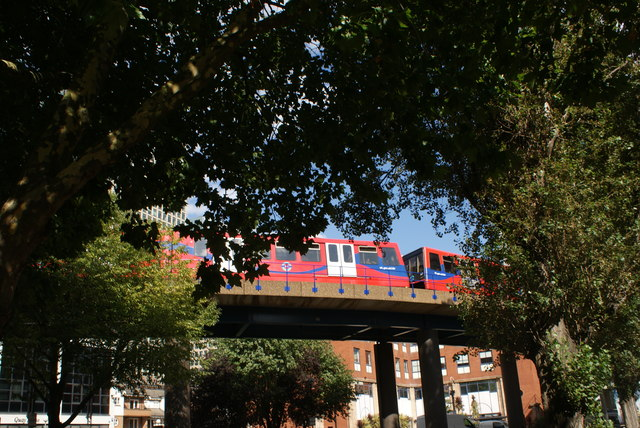 View of a DLR train rounding the curve between Heron Quays and South Quay station from Marsh Wall